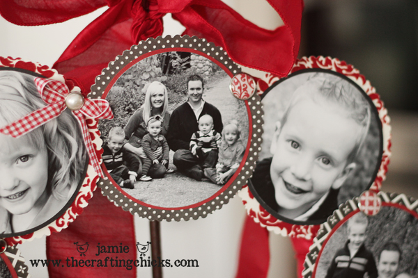 Black and white photos with embellishments on a red ribbon wrapped wreath to display.
