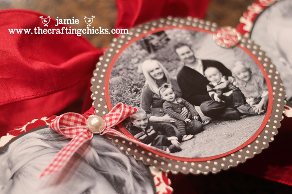 Attaching black and white family photos to a wreath with decorative brads and ribbon.