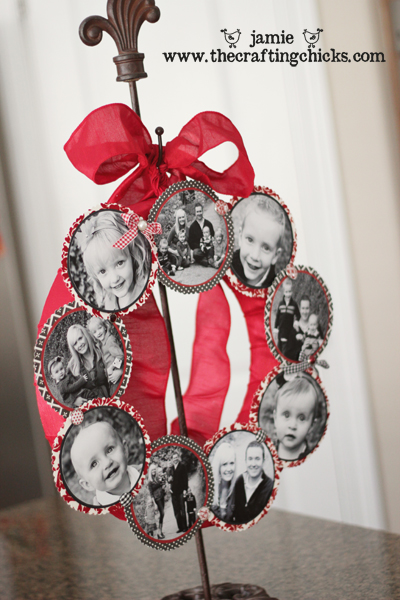 Family photo wreath with black and white family photos and red ribbon displayed on a wreath hanger.