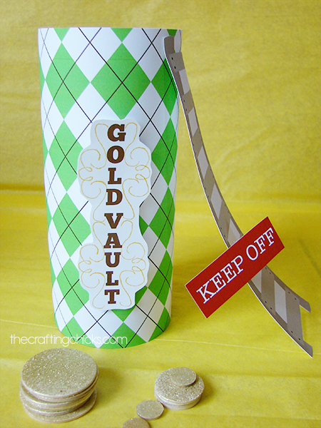 Leprechaun trap made out of a cookie can with scrapbook paper