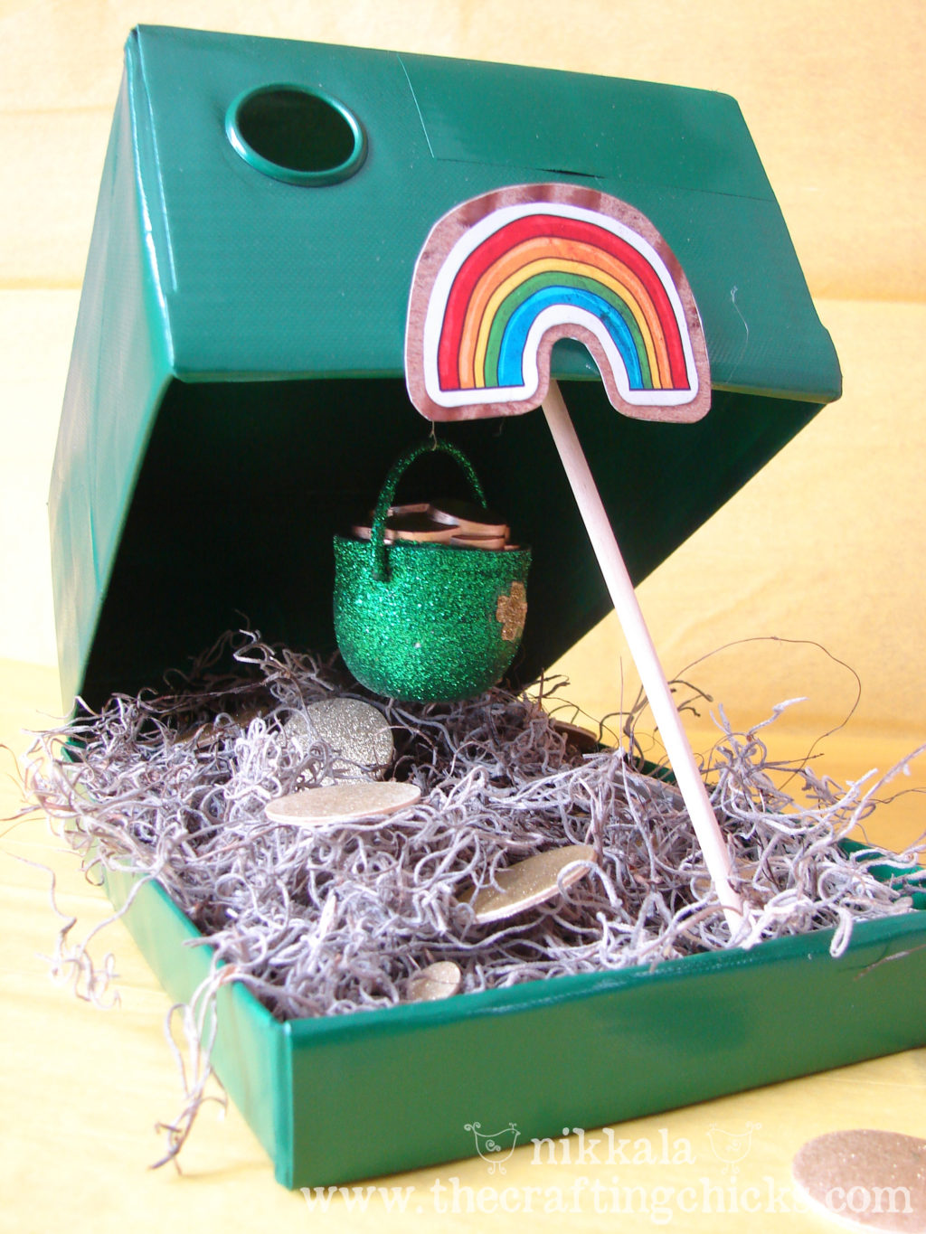 Leprechaun Trap made out of an old shoe box. Painted green with a treasure inside.