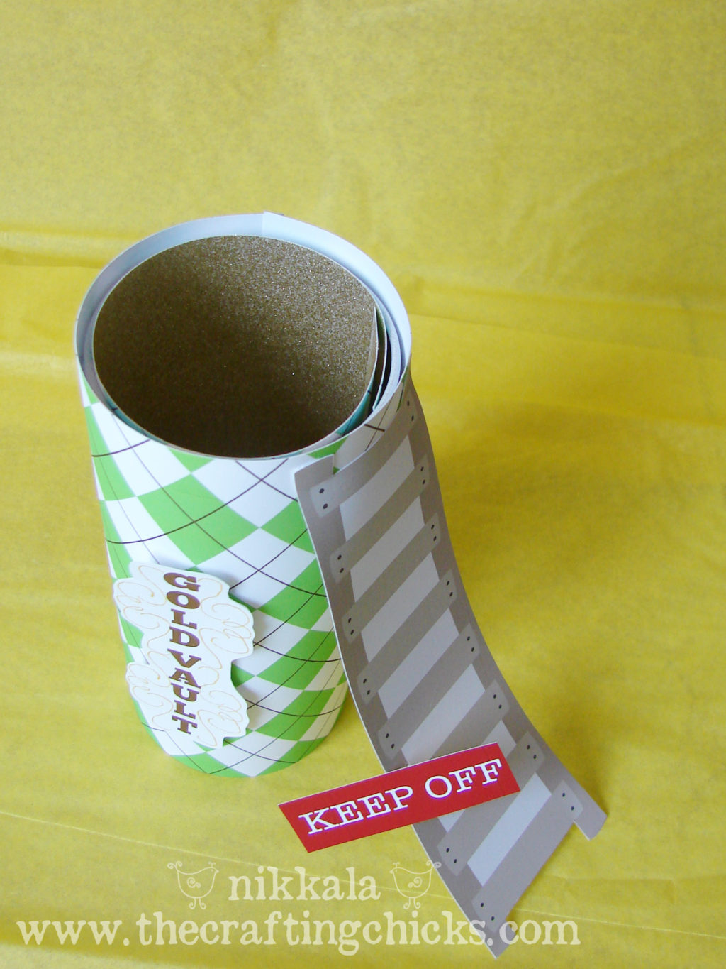 Leprechaun trap made with scrabbook paper and an old chip can.