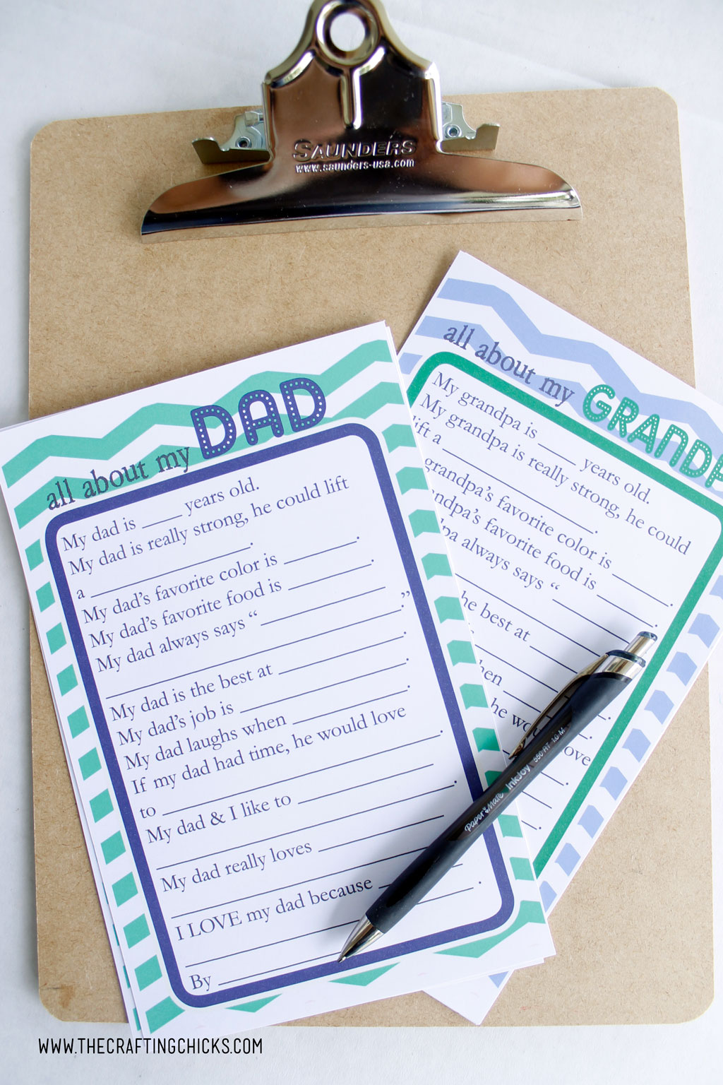 Dad and Grandpa Questionnaire for kids to fill out for Father's Day. Free Printable on clipboard with pen.
