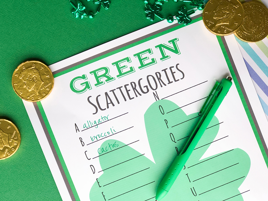St. Patrick's Day GREEN Scattergories Free Printable on a green background with gold coins and a green pen