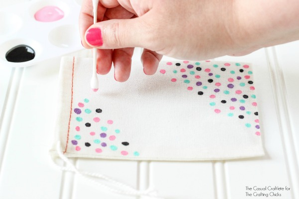 Add a painted confetti look to a muslin bag using paint and Q-tips