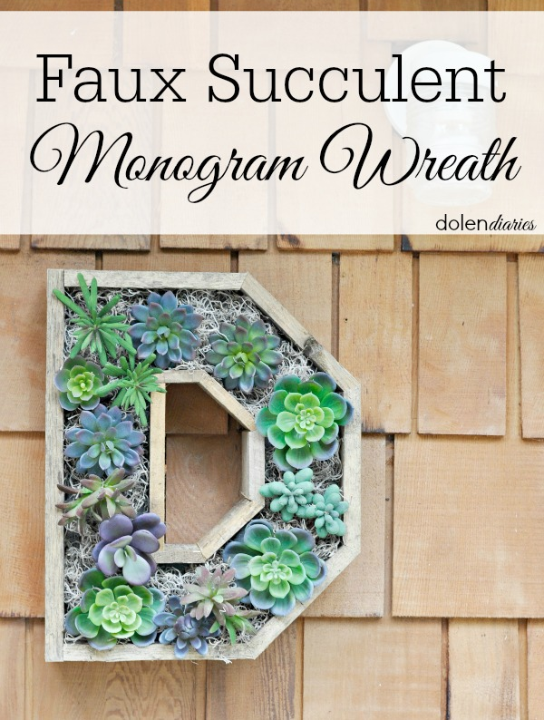 faux succulent wreath hanging on front porch