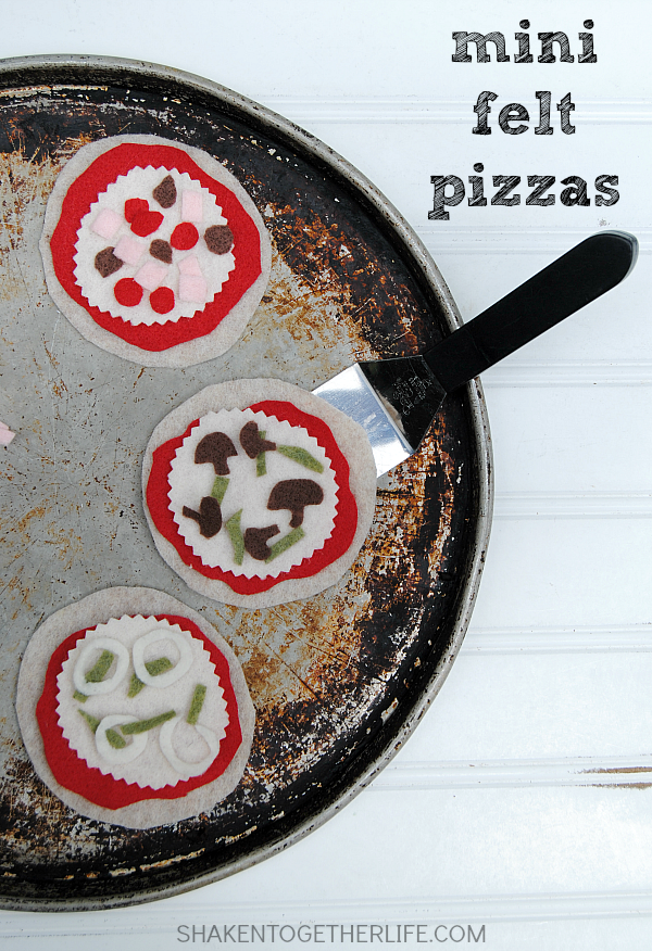 Gather the kids around the kitchen table to craft adorable mini Felt Pizzas! Let them add sauce, cheese and their favorite toppings - no oven required!