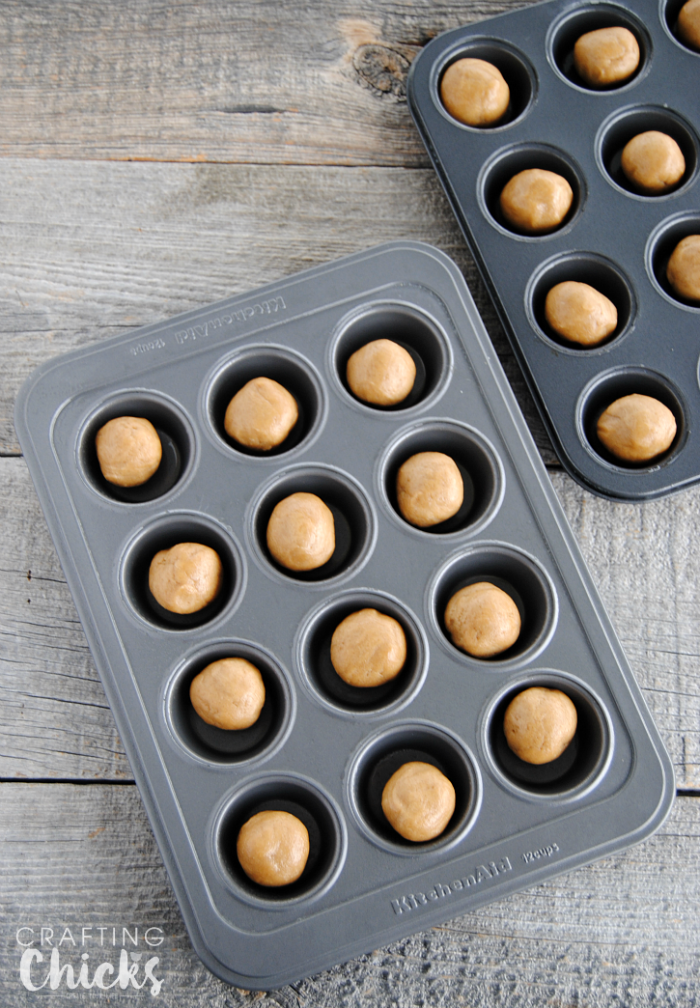 Roll pre-made peanut butter cookie dough into 24 balls - such an easy start to these Fluffernutter Cookie Cups!