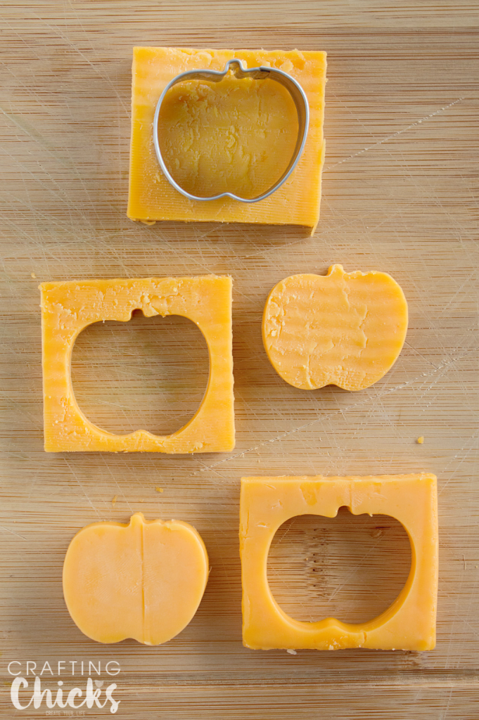 Use a mini apple cookie cutter to make apple shaped cheese for our Apple Themed Lunch! What a cute idea!