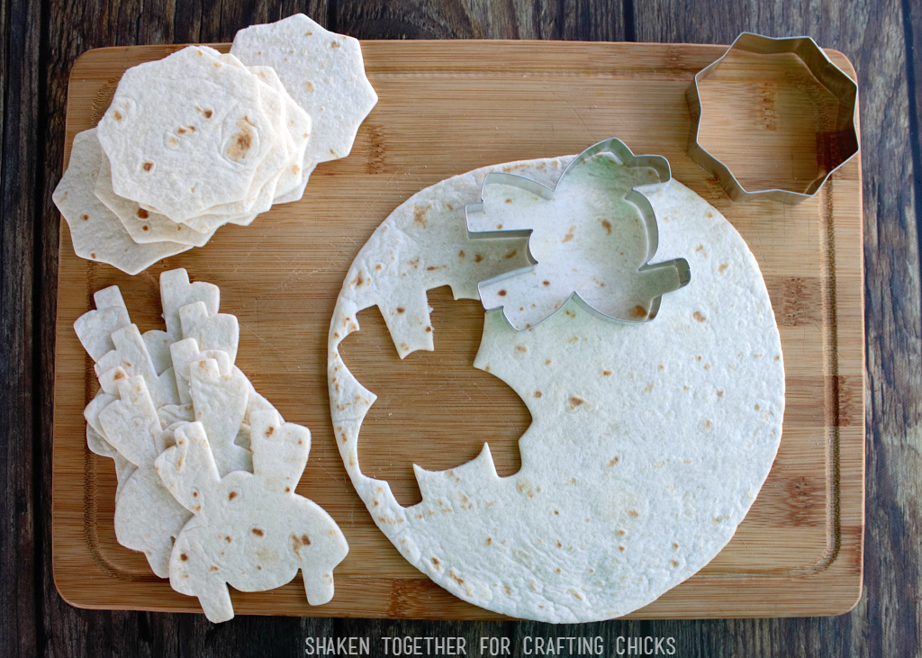 Cinnamon Sugar Spider Chips start with flour tortillas and Halloween cookie cutters