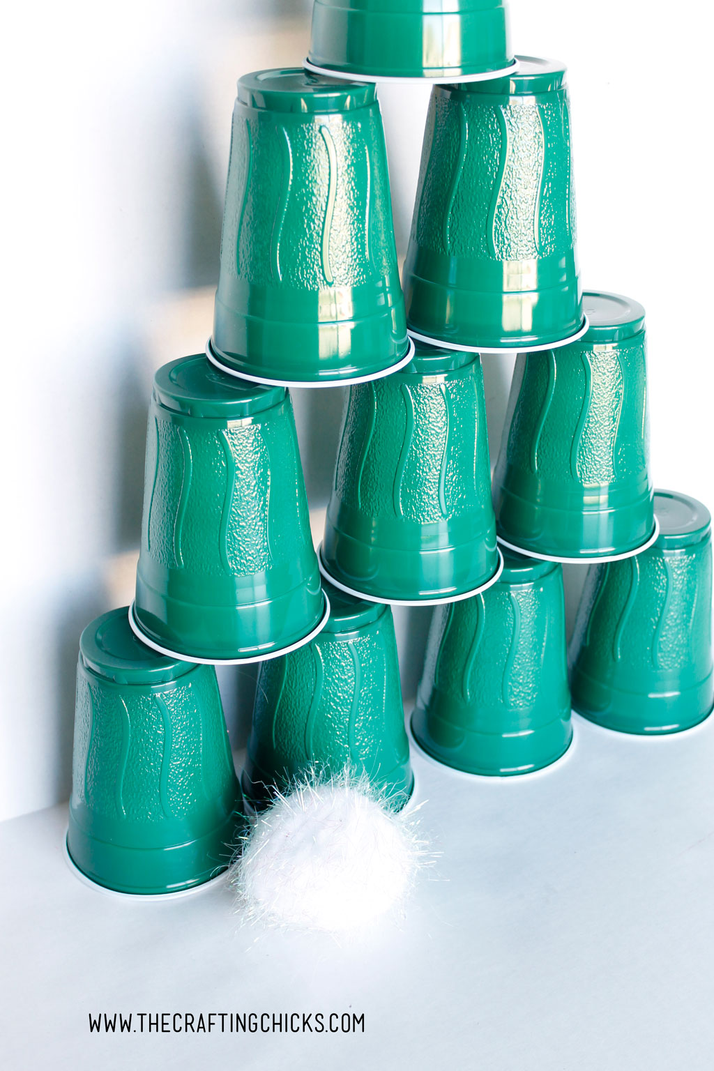 Stacking Cups Christmas Tree Game is a winner! From preschool age to elementary kids, everyone will love knocking down this Christmas Tree with a snowball.