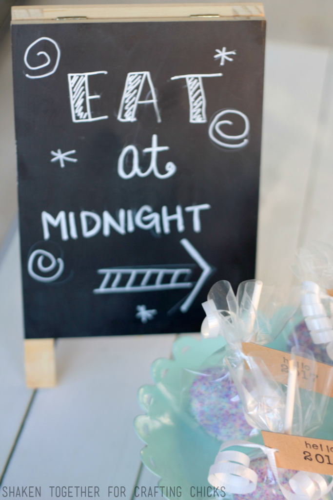 LOVE this Eat at Midnight chalkboard easel - cute touch with the Ball Drop Oreo Pops for New Year's Eve!
