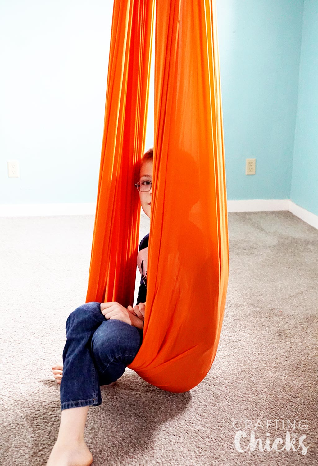 SPD Therapy Swing - What you need to set up a therapy gym at home for sensory processing disorder.