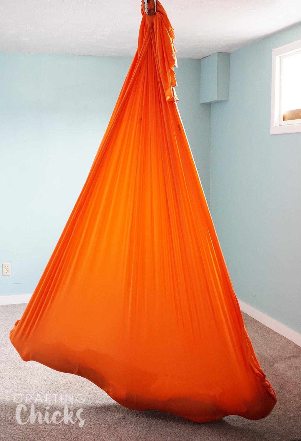 Yoga Hammock for SPD therapy - What you need to set up a therapy gym at home for sensory processing disorder.