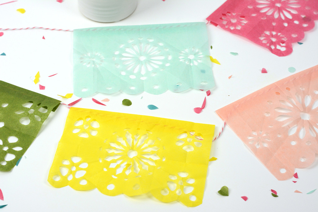 DIY Cinco de Mayo Fiesta Banner - Learn how to make a Cinco De Mayo fiesta banner using tissue paper, scissors and the easiest video tutorial that will take you step-by-step with each cut.