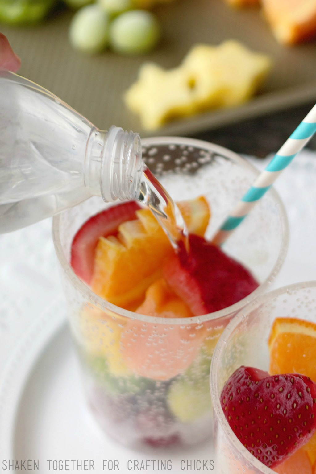 Rainbow Fruit Water with Frozen Fruit - once the frozen fruit is layered in the glass, add regular or sparkling water!