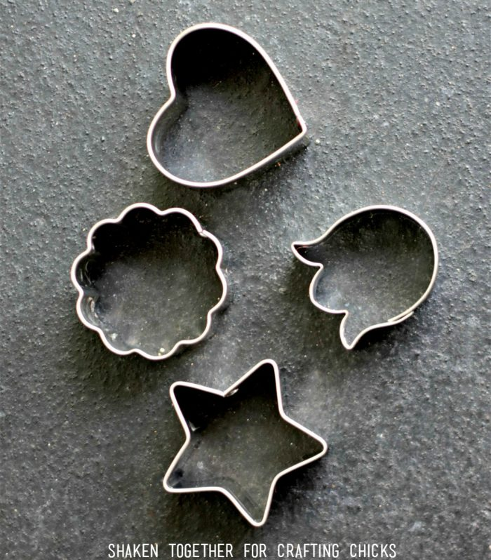 Make Rainbow Fruit Water fun by using mini cookie cutters to cut fruit into fun shapes!