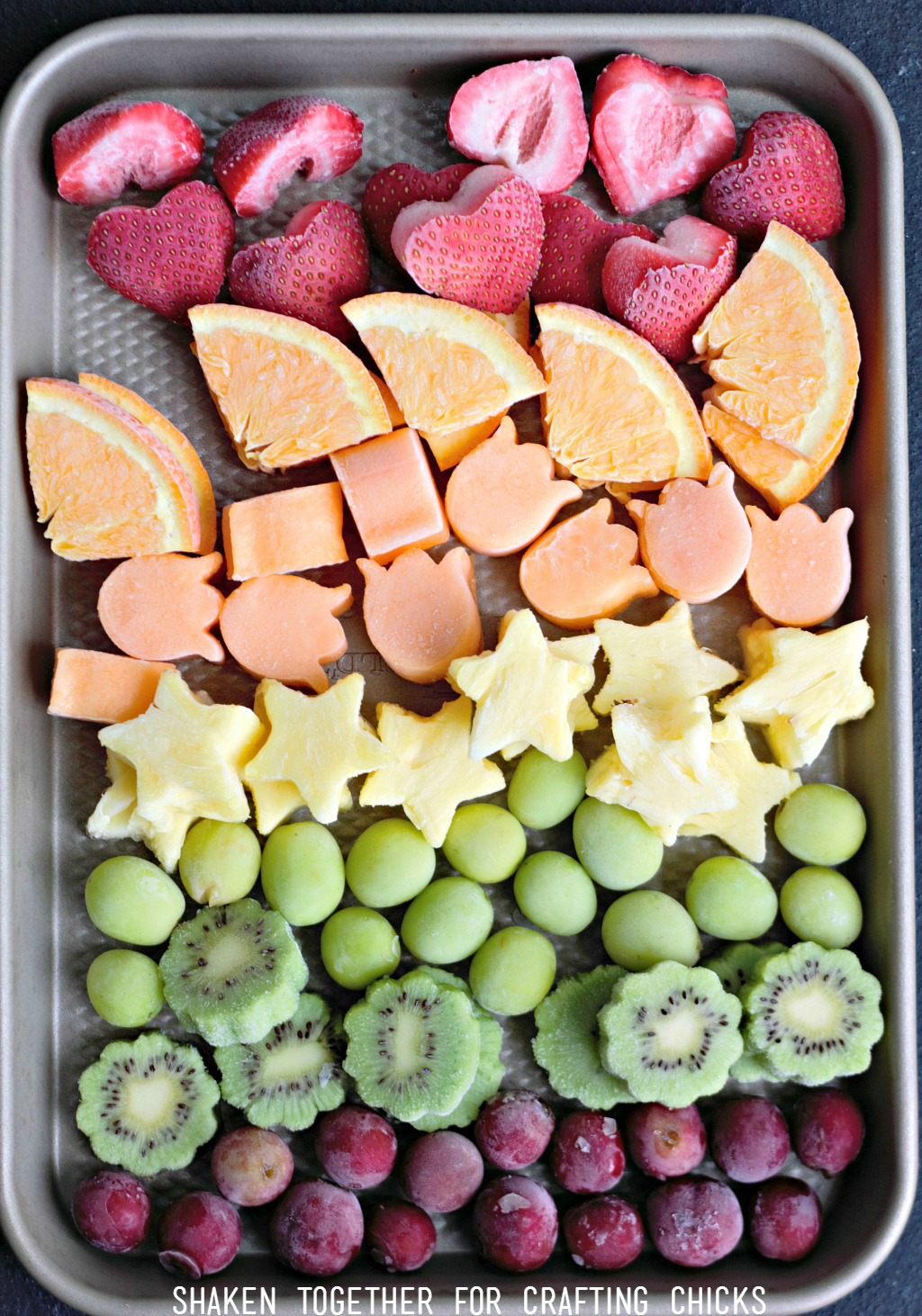 Frozen fruit is the healthy secret to our Rainbow Fruit Water! Kids and adults will love this refreshing Summer drink!