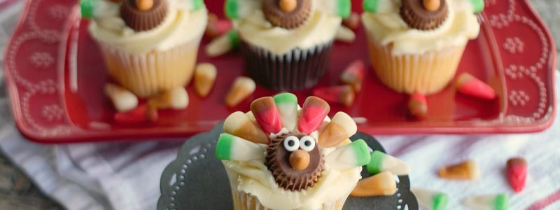 Colorful candy feathers and the cutest little faces, these Candy Corn Turkey Thanksgiving Cupcakes will be gobbled up in no time!