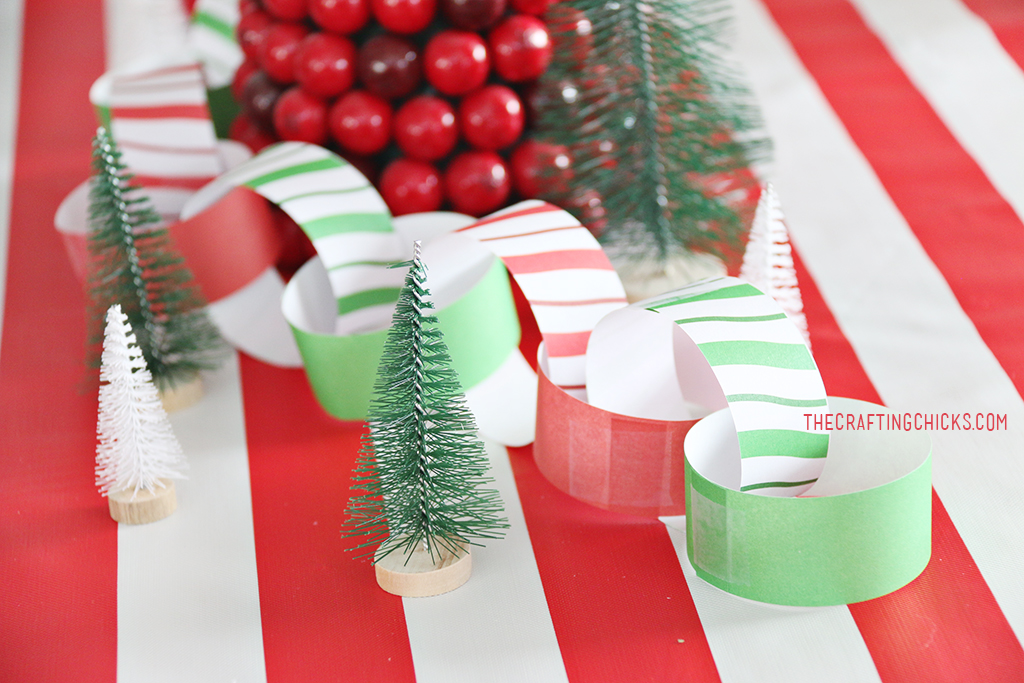 Christmas Breakfast Table with bright red and green decorations and a paper chain.