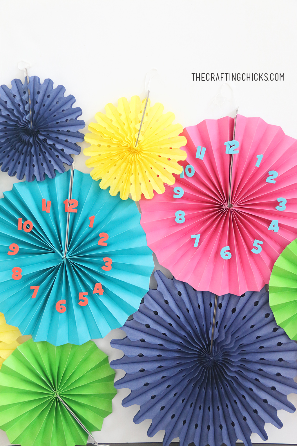DIY New Year's Eve Party Clocks are perfect for any new year's eve party. This craft is easy enough for kids to create.