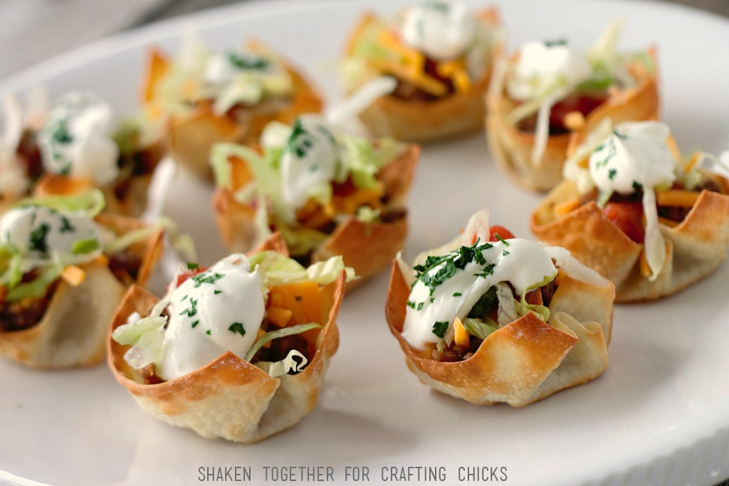 Mini Taco Cups are the perfect easy appetizer for New Years Eve or the big game! The wonton cups can be made in advance to make assembling this taco appetizer easy!
