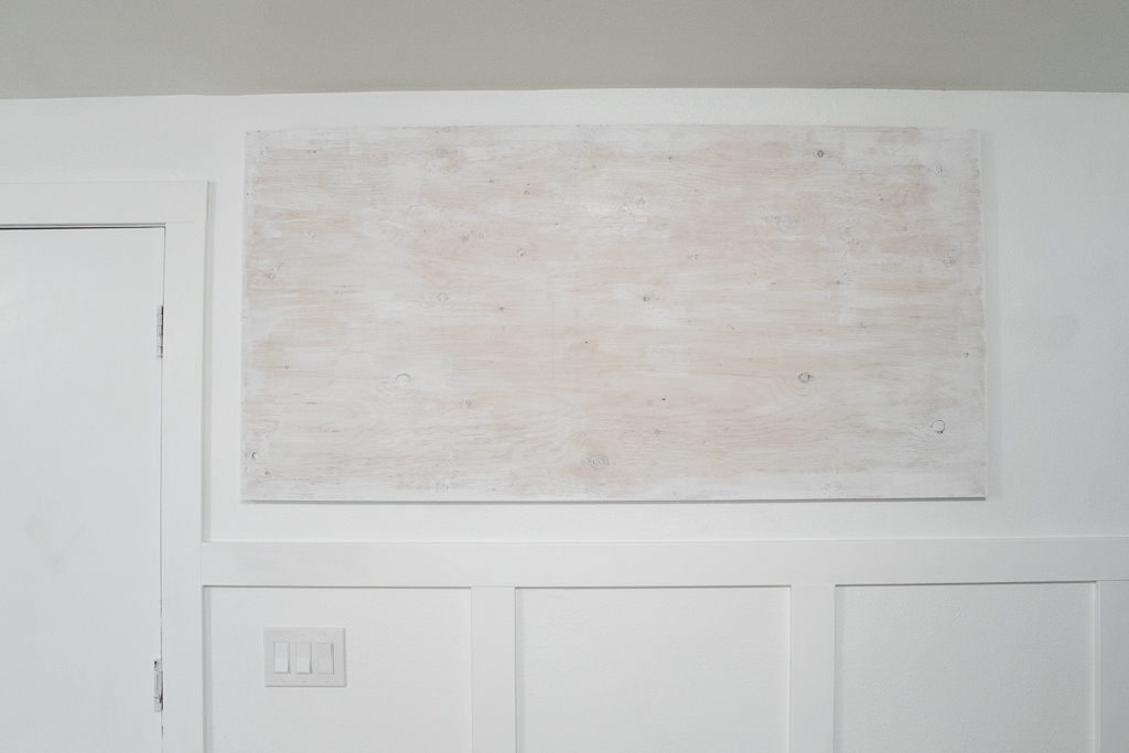 White washed board for family command center.