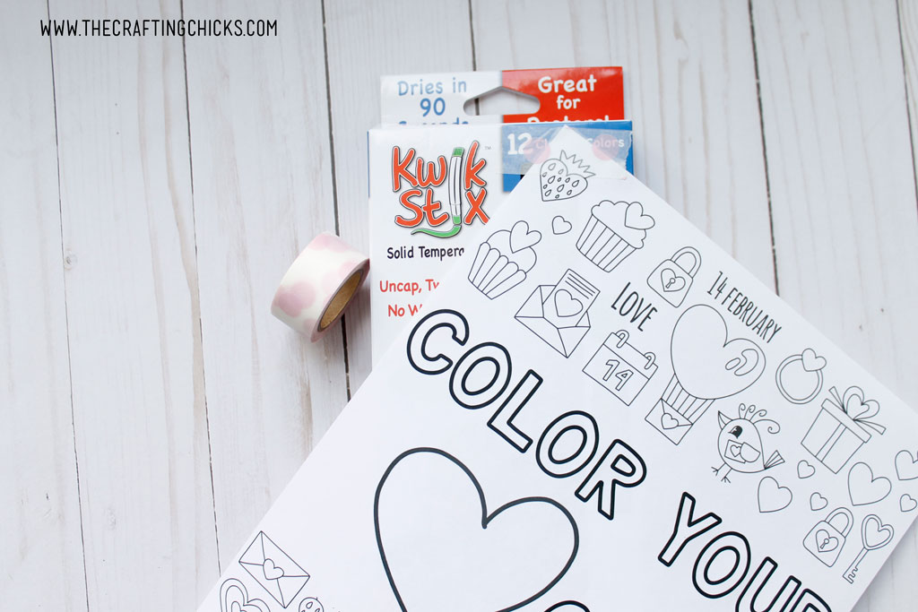 Just print out the Free Color Your Heart Out Valentine Coloring Page, and attach to a Kwik Stix box with some Washi tape. The Washi Tape pulls off really easy so it doesn't ruin the coloring page or the Kwik Stix box.