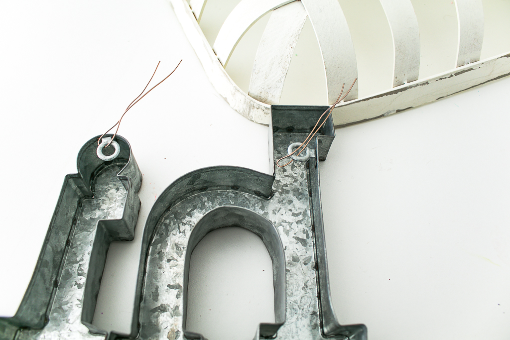 Attaching galvanized metal piece to spring wreath