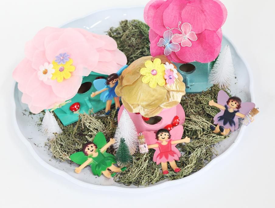 fairy garden with a green, pink and purple fairies