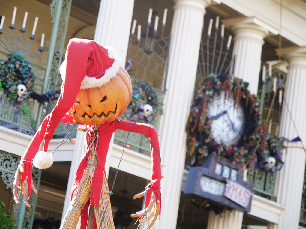 Jack Skellington dressed as Santa in front of the Haunted Mansion at Disneyland Resort
