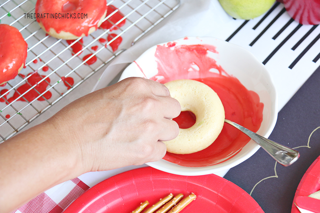 Dipping apple donuts