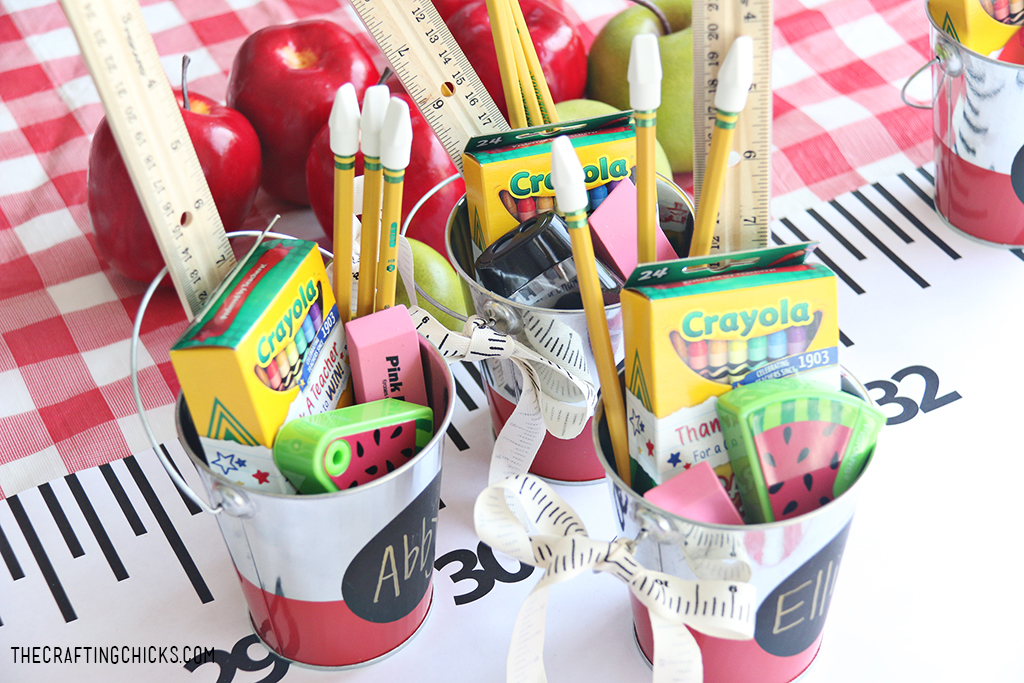 back to school supplies in a cute tin bucket for a gift idea