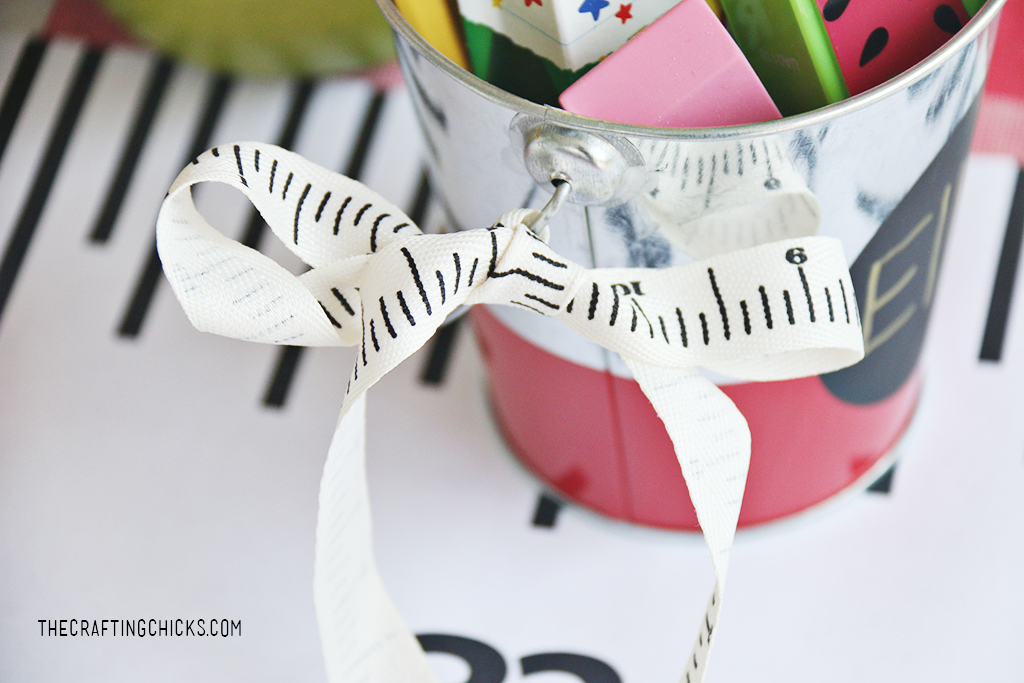 Ruler ribbon tied onto a tin bucket for a gift idea