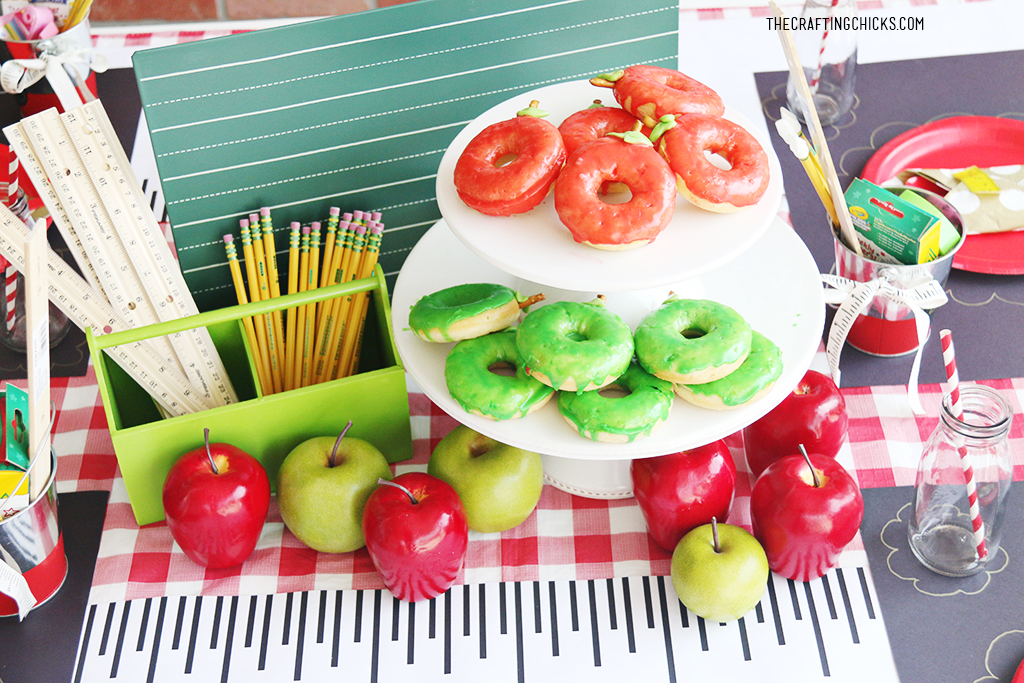 Back to school party, apple donuts on serving tray