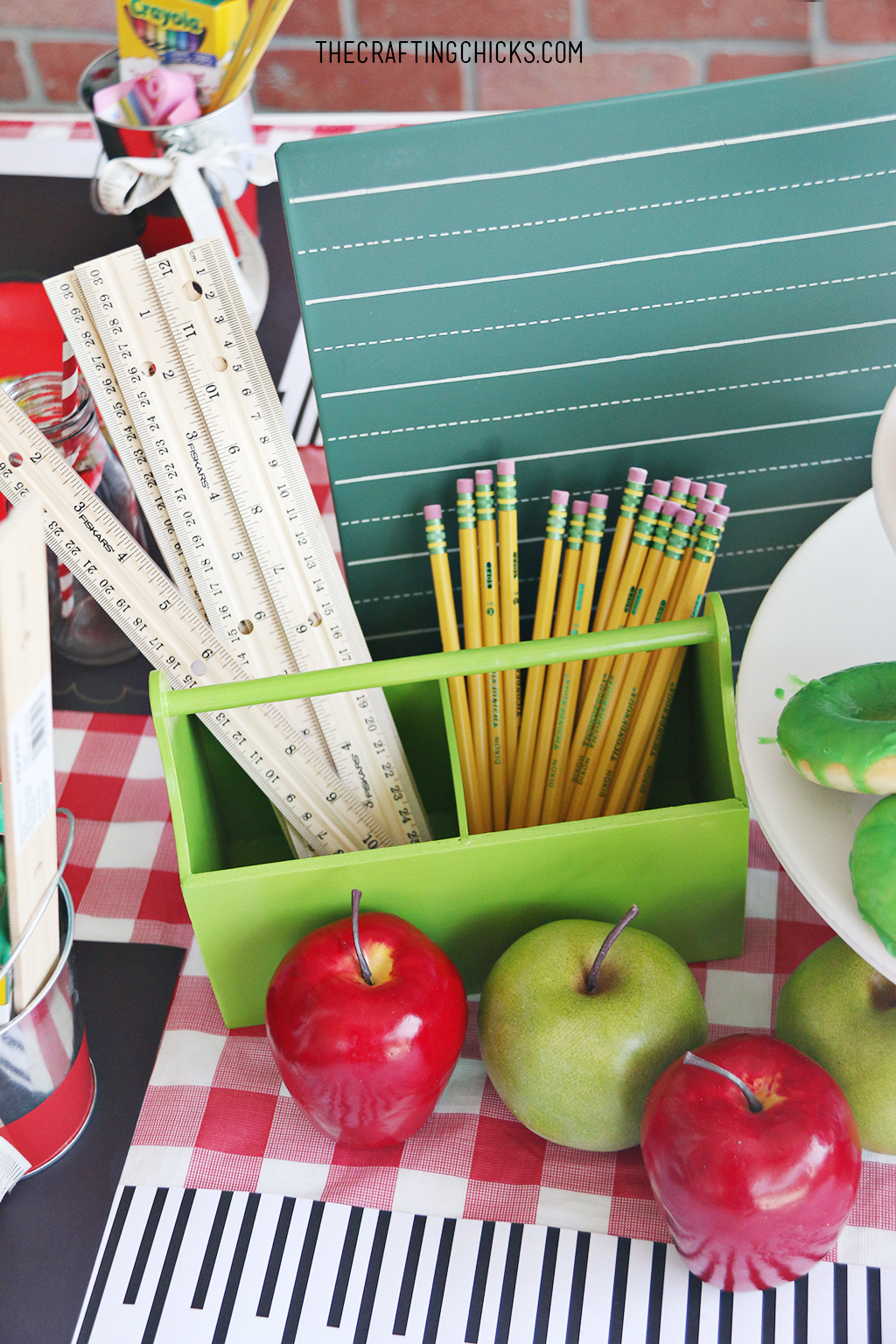 back to school party table, apples and apple donuts