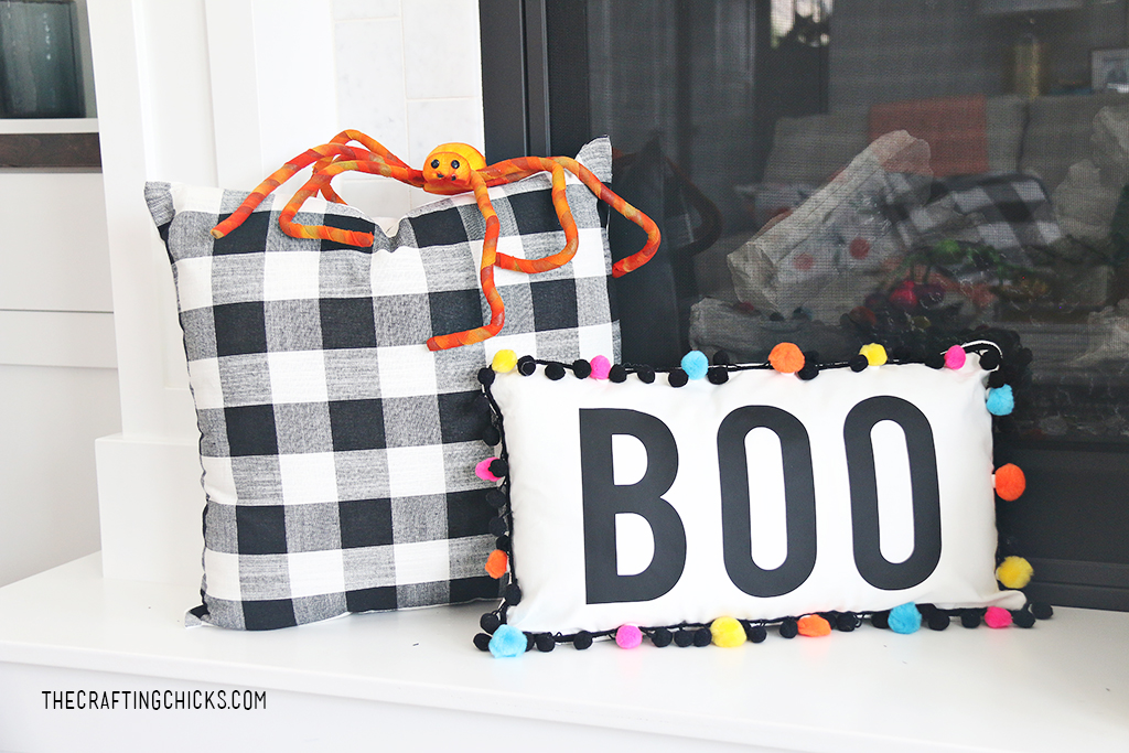 Boo Pillow with bright colorful pom poms around as trim for Halloween decor