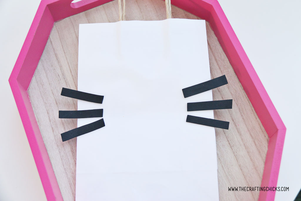 white gift bag with black whiskers to make hello kitty gift bag