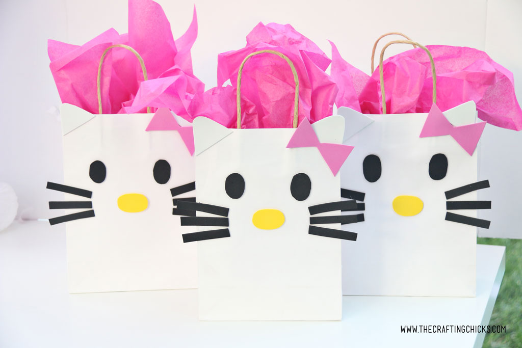 Bright pink tissue paper added to white gift bag to make a DIY Hello Kitty Gift Bags