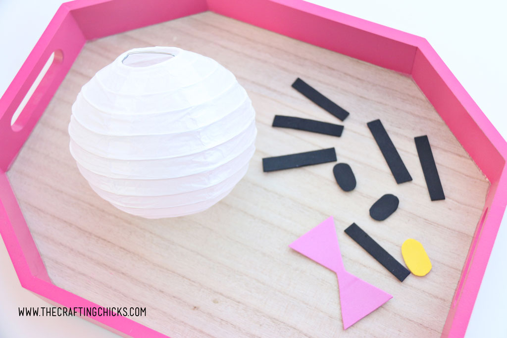 White mini paper lantern with cut out foam shapes to make Hello Kitty DIY Paper Lanterns