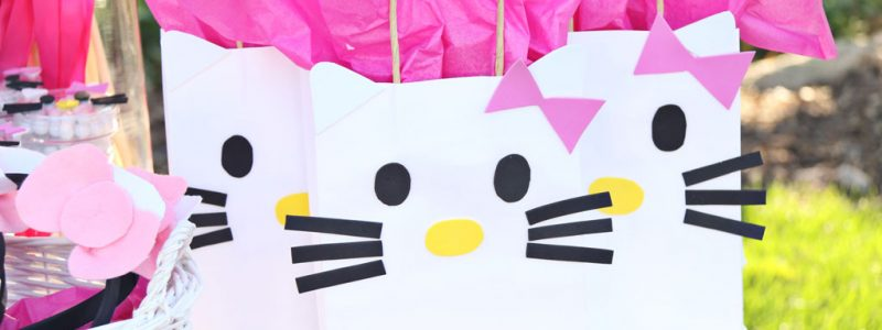 Hello Kitty DIY Gift Bags on party table for Hello Kitty Party