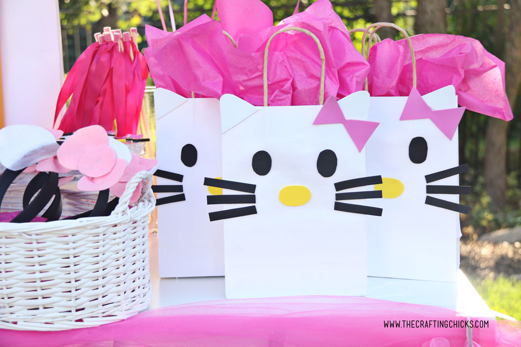 Hello Kitty DIY Gift Bags on table at a hello kitty party