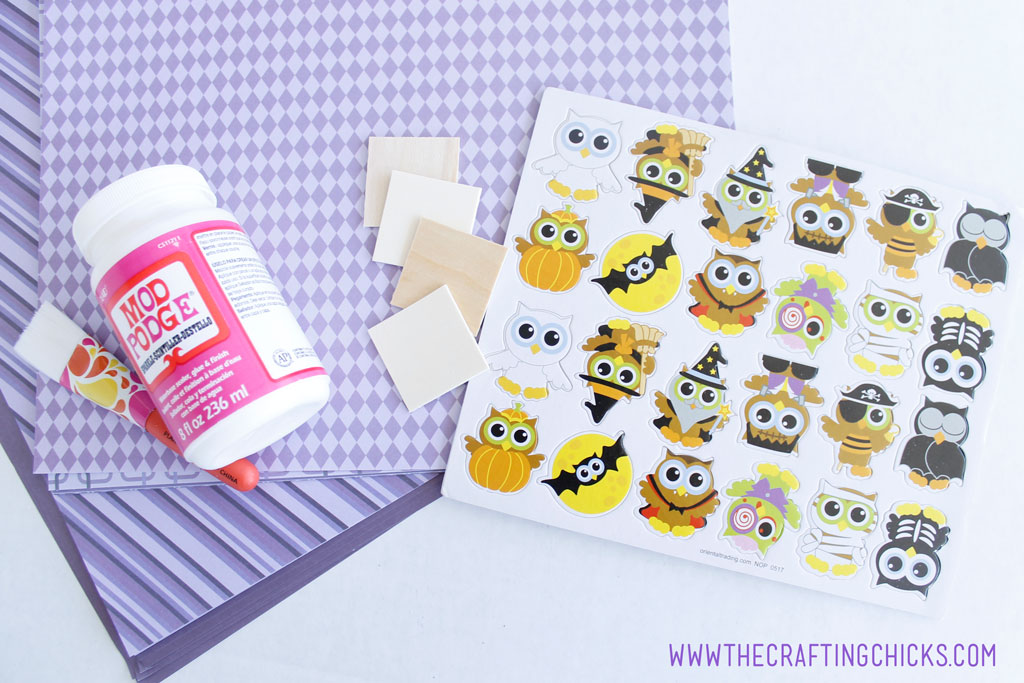 Purple scrapbook paper, wooden squares, sparkle Mod Podge, Halloween Owl stickers are what you need to make Halloween Owl Memory Game