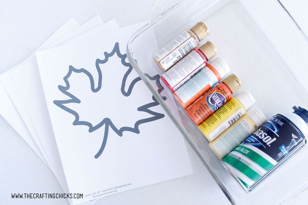 Printable Leaves, fall paint colors and shaving cream on table as supplies you need to make Shaving Cream Fall Leaves