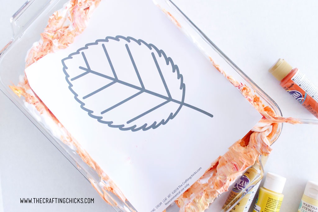 Fall leave printable in the shaving cream and paint mixture.