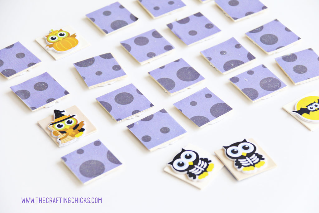 Halloween Owl Memory game with wooden pieces covered in purple paper and puffy owl stickers on the back.