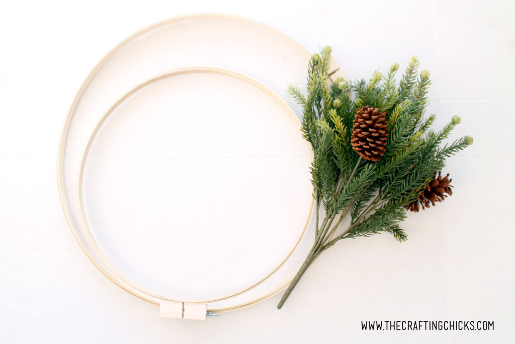 2 large embroidery hoops and a bunch of faux pine.