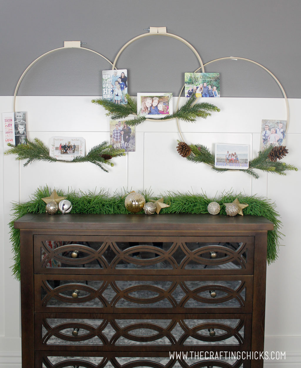 Winter hoop wreaths decorated with Christmas and holiday cards with pine sprigs.