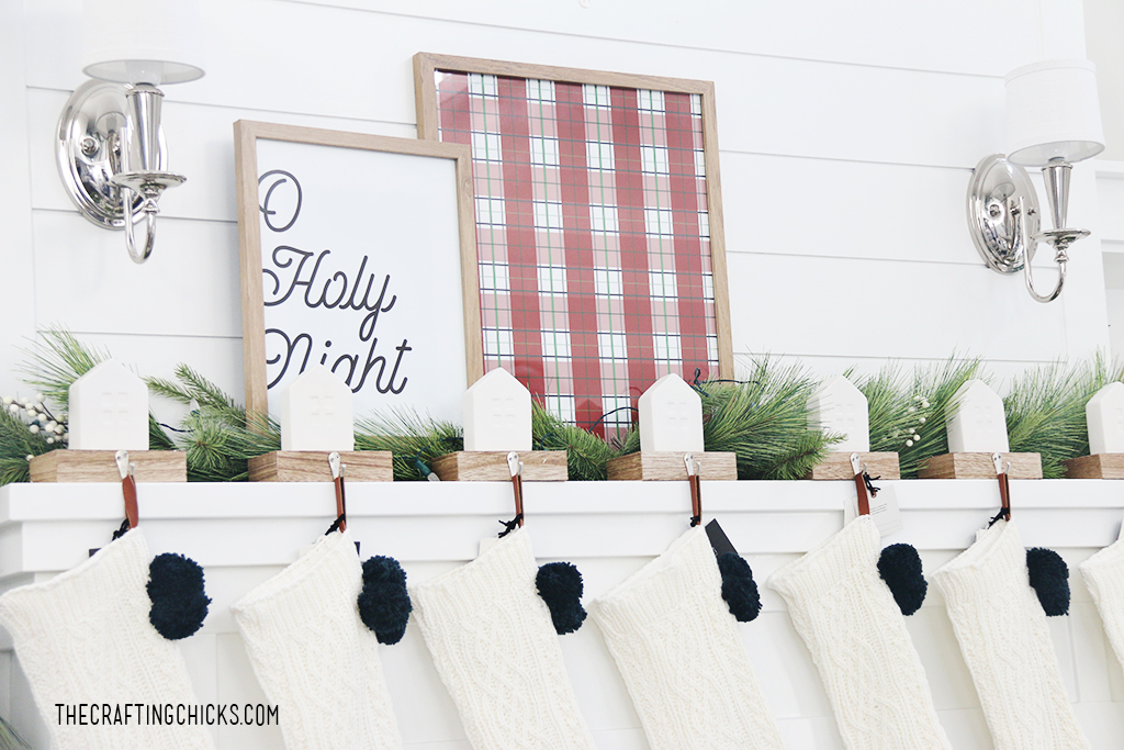 Oh Holy Night Printable framed on a white Christmas Mantel with red plaid background print