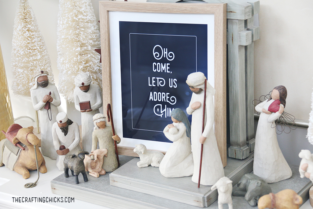 Oh Come Let Us Adore Him print near a nativity